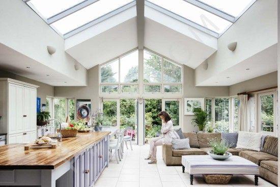 Open plan kitchen floor tiling skylight timber countertops seating garden views patio glass door